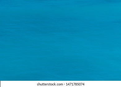 Sea surface. Blue texture. Azure sea. Azure and turquoise backgrond. Marine waves.