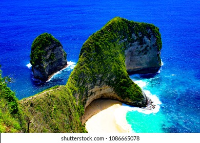 The sea surrounding Nusa Penida near Bali is a deep exotic blue color. This place was made famous on Instagram.