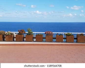 sea view terrace with flower pot in Alassio, Italy