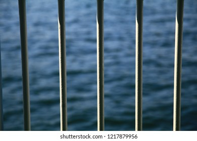 The sea through the handrail of a ship