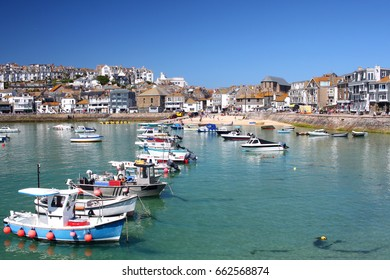 Sea town with shops, marina, and boats
