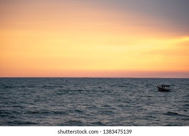 Sea view after sunset. See fishing boats that are far away.