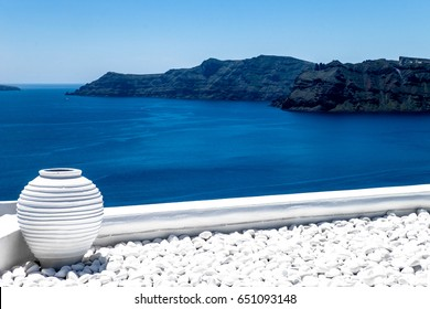 Sea view from balcony in cycladic style with amphora. Oia, Santorini island, Greece