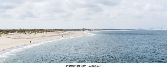 Sea view and beach at the estuarine of the Oosterschelde area in The Netherlands Zeeland seen from the Oosterscheldekering