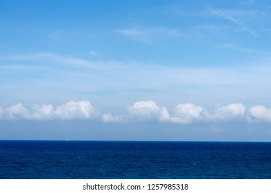 Sea view and blue sky full of clouds during day light - Image