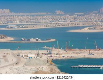 sea view in Dubai city, construction cranes