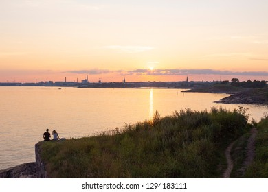 Sea view of the Gulf of Finland, a beautiful summer sunset on the rocky shore of the island of Suomenlinna in Finland. Suomenlinna is a favorite place for outdoor recreation near Helsinki.