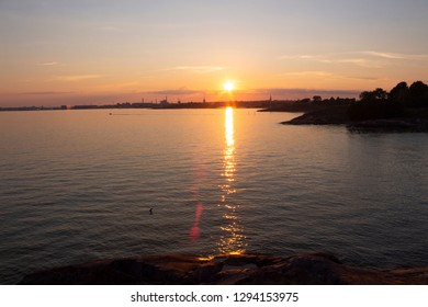 Sea view of the Gulf of Finland, summer evening and sunset off the coast of the island of Suomenlinna near the city of Helsinki in Finland.