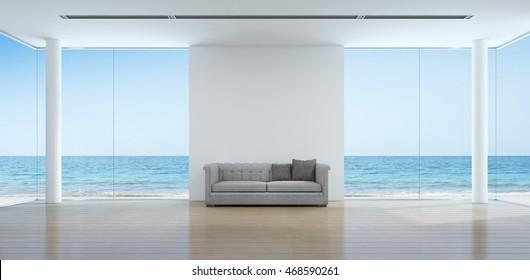 Sea view living room interior in modern beach house - 3D rendering