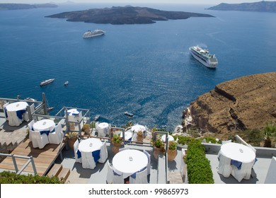 Sea view on moored yacht and sailboat as seen from the restaurant'??s terrace on cliff Santorini luxury island, Greece