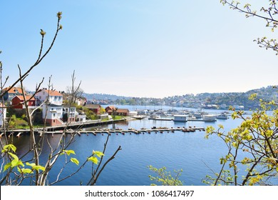 Sea view over the sea. Arendal city, Norway. city view, Arendal, Norway in the spring time on the  nice sunny day. boats sit moored at the city habour With colorful house along the sea.
