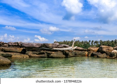 Sea view, rocks and bright sky at Koh Kood Island in Trat province of Thailand.