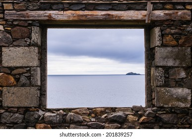 Sea view from a stone window of an old ruin near the ocean in the Isle of Harris, Scotland, UK.