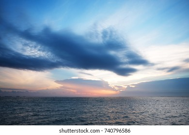 Sea view at sunset with cloudy sky. Twilight seascape photo.