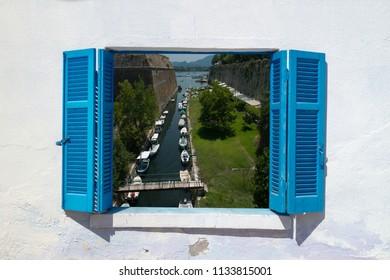 Sea view through traditional greek window