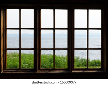 Sea view through window in sunny day