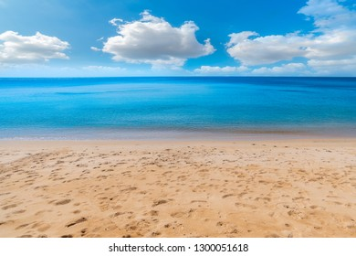 Sea view from tropical beach with sunny sky. Summer paradise beach . Tropical shore. . Exotic summer beach with clouds on horizon. Ocean beach relax, outdoor travel