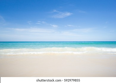 Sea view from tropical beach with sunny sky.Summer paradise beach of Phuket island.Exotic summer with clouds on horizon.