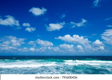 Sea view from tropical beach with sunny sky
