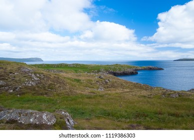 Sea view under cloudy sky from hilly coast in Torshavn, Denmark. Beautiful landscape view. Beauty of nature. Wild sea beach. Environment and ecology. Summer vacation and wanderlust.