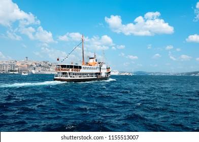 Sea voyage with old ferry (steamboat) on the Bosporus - Istanbul, Turkey. Istanbul Bosphorus Bridge