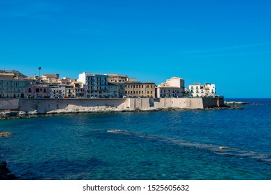 The sea wall protecting the island of Ortygia at Syracuse on the Italian island of Siciy