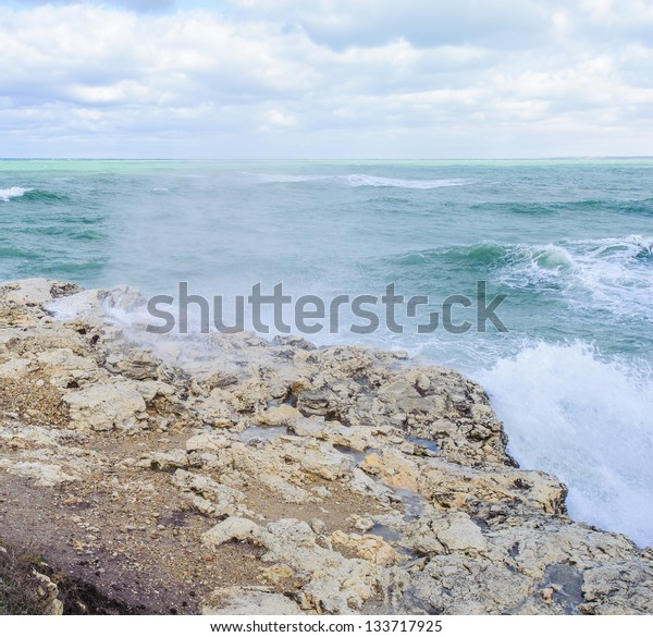Sea water is crashing over the rock. The Black Sea is a sea in south-eastern Europe.