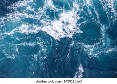 sea water splash texture - blue transparent fresh ocean water background