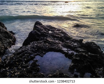 Sea Water Waves Caught On The Rocks At Batu Bolong Beach, Canggu Village, Badung, Bali, Indonesia