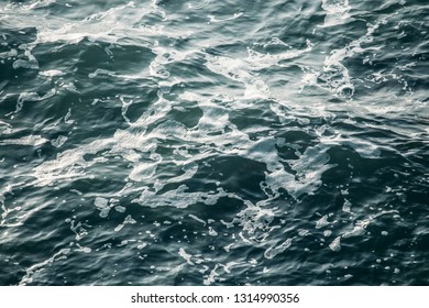 Sea water waves, ocean surface background, abstract aqua or liquid texture, toned