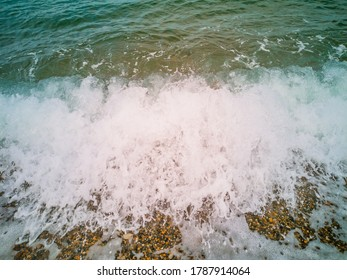 sea wave brakes on the beach