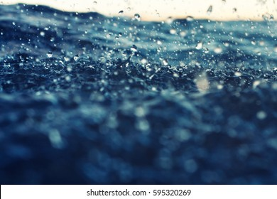 sea wave close up at sunset in the rain, low angle view