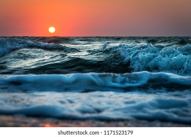 Sea wave close up, sunrise