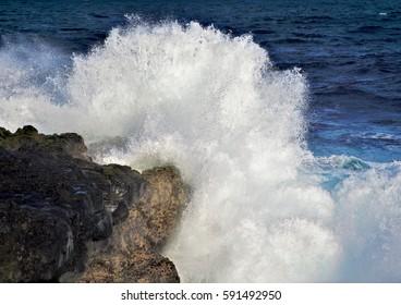 Sea wave explosion on rocks in the ocean