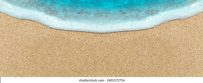 Sea wave on beach sand