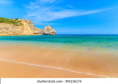 Sea wave on golden sand Barranco beach on western coast of Portugal