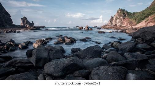 sea waves between rock at Watu Lumbung beach, Jogjakarta
