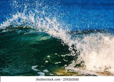 Sea waves break on the shore