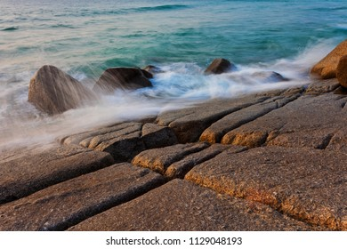 Sea waves breaking on the stones of the coast