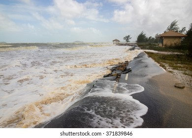 Sea waves caused by a heavy storm hit and destroy a paved road