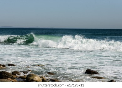 Sea waves at the coastline on a sunny day