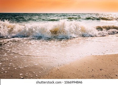 Sea Waves During Storm During Sunset Or Sunrise. Ocean Waves Washing Coast Sand Beach.