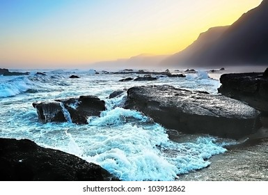 The sea waves fighting about stones