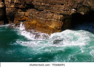 Sea waves hitting rock cliffs at Boca do Inferno, Cascais, Portugal