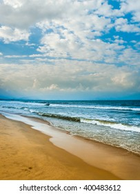 Sea waves near beach in Da Nang city, Vietnam. Traditional fishing boats are in the distance. Beautiful image of vietnamese nature.