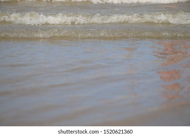 Sea waves on the shore of the beach