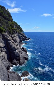 The sea and waves in the rocks in Portofino, Italy