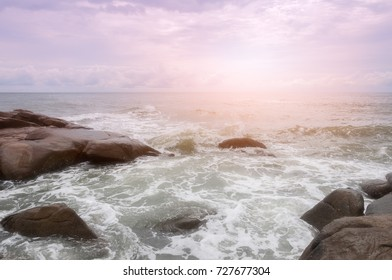 The sea waves rolling on stones