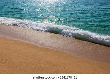 Sea waves and sandy beach