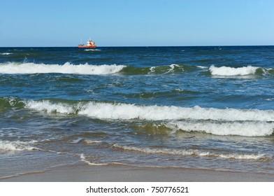 sea waves, a ship at sea